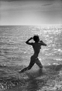 artistic nude running in sea