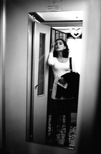 fashion reportage looking in mirror
